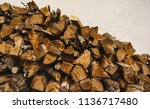a pile of stacked firewood ... | Shutterstock . vector #1136717480
