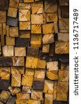 a pile of stacked firewood ... | Shutterstock . vector #1136717489