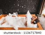 happy woman playing with foam... | Shutterstock . vector #1136717840
