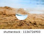 glass ball at the sand beach    Shutterstock . vector #1136726903