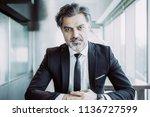 closeup portrait of serious... | Shutterstock . vector #1136727599