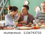 friends cooking together in... | Shutterstock . vector #1136743733