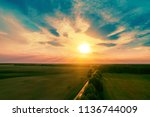 aerial view of a country road... | Shutterstock . vector #1136744009
