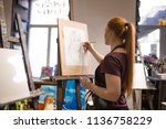 a girl in an art studio draws a ... | Shutterstock . vector #1136758229