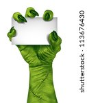 Stock photo zombie hand holding a blank sign card as a creepy halloween or scary symbol with textured green 113676430