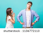 young woman pleased her man... | Shutterstock . vector #1136772113