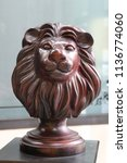 Small photo of lion wood head