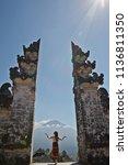 woman in bali gates volcano... | Shutterstock . vector #1136811350