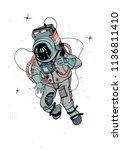 astronaut in spacesuit.... | Shutterstock . vector #1136811410
