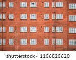 facade of a red brick mansion... | Shutterstock . vector #1136823620