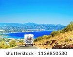 RV Camper Van Car with bicycles on Road. Caravan and motorhome in the road trip  in Provence, Azure Coast, France. In front of the sea and mountains. - stock photo