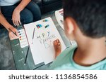 little boy and his mother are... | Shutterstock . vector #1136854586