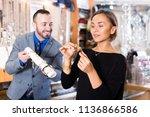 adult buyer woman choosing gold ... | Shutterstock . vector #1136866586