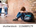 little boy sitting alone on... | Shutterstock . vector #1136889179