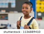 african young girl with blue... | Shutterstock . vector #1136889410