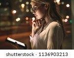 business woman standing in her... | Shutterstock . vector #1136903213