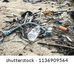 an abandon bottle and a lot of... | Shutterstock . vector #1136909564