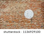 a wall of old red orange brick... | Shutterstock . vector #1136929100