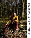 macho spends time in park. man... | Shutterstock . vector #1136952920