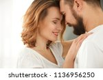 lovely couple dancing together... | Shutterstock . vector #1136956250