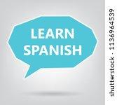 learn spanish written on speech ... | Shutterstock .eps vector #1136964539