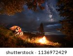 camping at night. young couple... | Shutterstock . vector #1136972429
