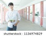 happy teen high school students ... | Shutterstock . vector #1136974829