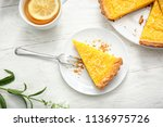 plate with piece of tasty lemon ... | Shutterstock . vector #1136975726