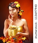 Woman with  autumn hairstyle  holding gift box. - stock photo