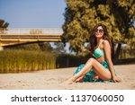 hot sexy brunette in a...   Shutterstock . vector #1137060050