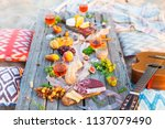picnic on the beach at sunset...   Shutterstock . vector #1137079490