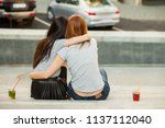 two girls hugging and drink...   Shutterstock . vector #1137112040