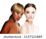 two wemen with dark and light... | Shutterstock . vector #1137121889