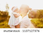 happy mother and little baby... | Shutterstock . vector #1137127376