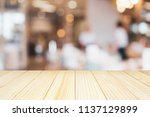 wood table top with cafe... | Shutterstock . vector #1137129899