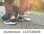 young volunteers with garbage... | Shutterstock . vector #1137130640