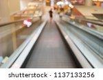 escalator in shopping store...   Shutterstock . vector #1137133256