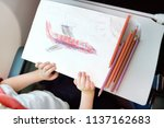 child traveling by an airplane. ... | Shutterstock . vector #1137162683