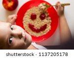 little girl eating appetizingly ... | Shutterstock . vector #1137205178