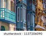 facade of colorful houses in... | Shutterstock . vector #1137206090