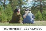 aristocrats men in the park.... | Shutterstock . vector #1137224390