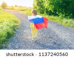 girl child is on the road with... | Shutterstock . vector #1137240560
