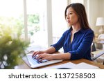 focused asian businesswoman... | Shutterstock . vector #1137258503