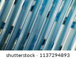 glass wall reflecting blue sky. ... | Shutterstock . vector #1137294893