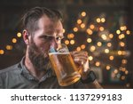 young hipster looking man... | Shutterstock . vector #1137299183