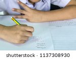 students doing math test by... | Shutterstock . vector #1137308930