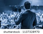 speaker giving a talk on... | Shutterstock . vector #1137328970