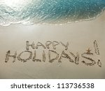 happy holidays  written in sand ... | Shutterstock . vector #113736538