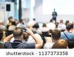 speaker giving a talk in... | Shutterstock . vector #1137373358