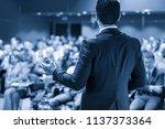 speaker giving a talk on... | Shutterstock . vector #1137373364